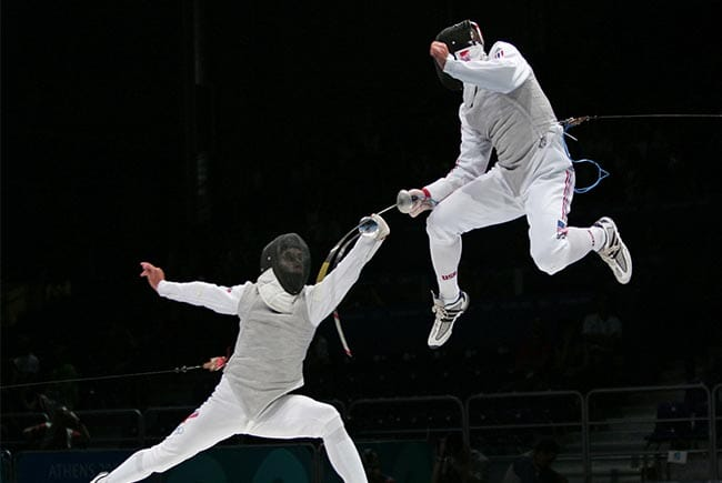 Fencers with one in a leap
