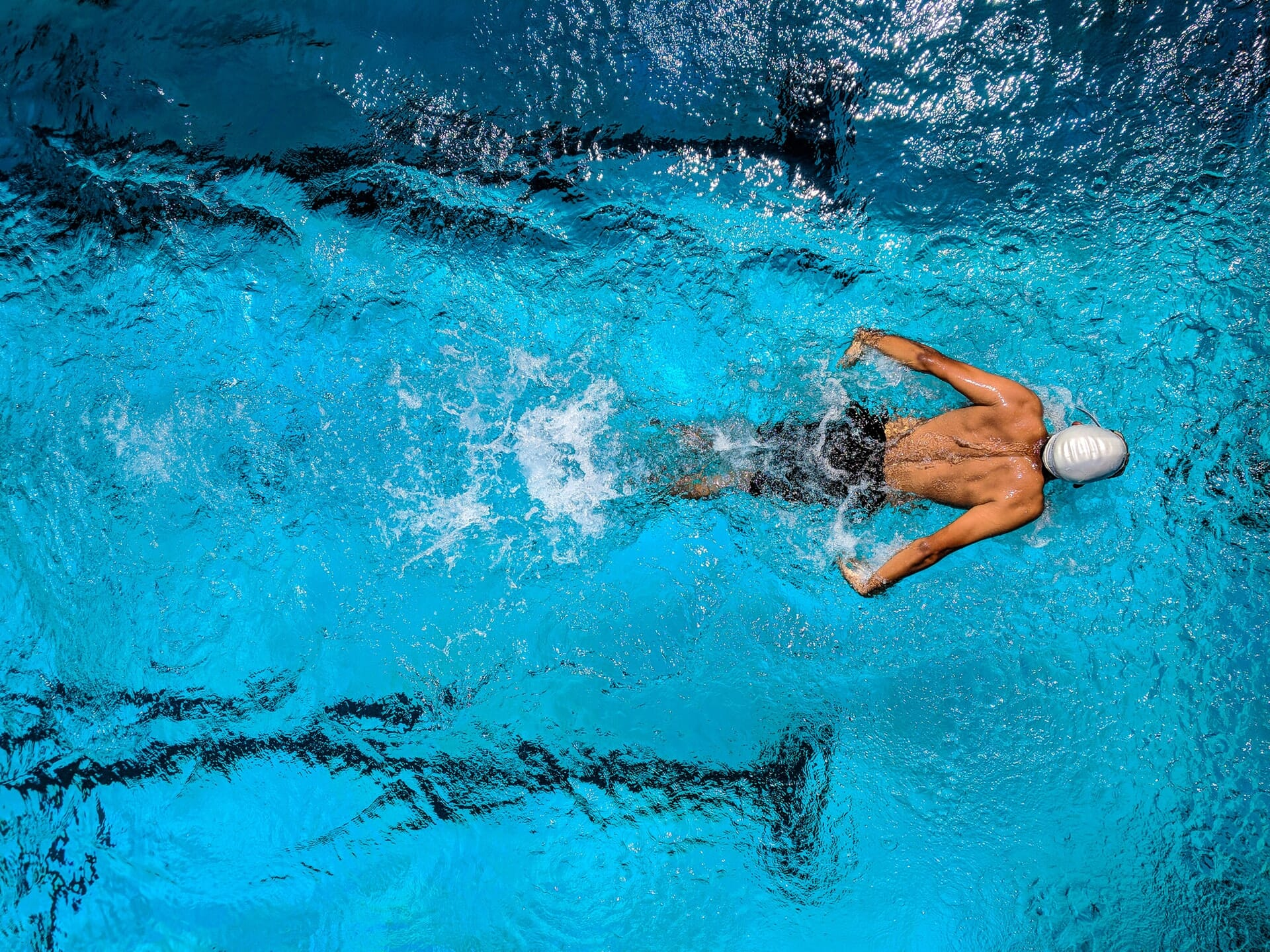 Swimmer from top doing butterfly