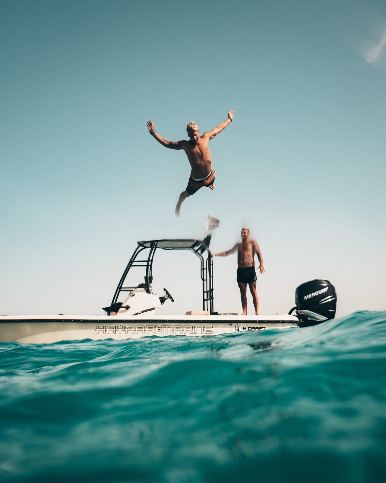 Diving high off of a moter boat