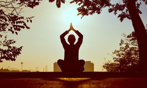 Yoga sit on hillside photo
